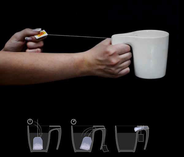 Необычная чайная кружка с приспособлением для отжима чайного пакетика